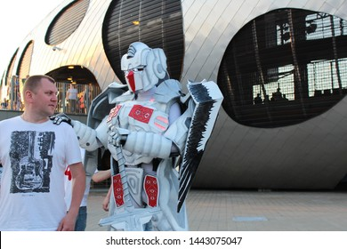 Borisov. Belarus. June 8, 2019. The official symbol of the Belarus national football team is a white-red robot with wings and a sword standing near the stadium and entertains fans before the Belarus-G