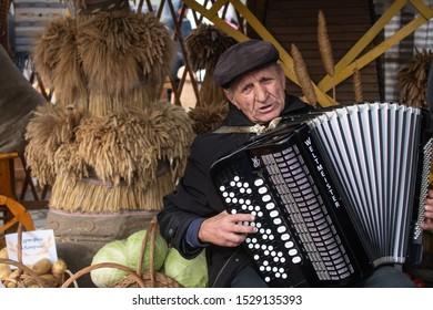 Borisov, Belarus - October 12, 2019: An elderly man plays the accordion.