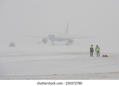 BORISPOL, KIEV, UKRAINE - FEBRUARY, 5, 2015:  Staff at the Borispol Airport observed the aircraft landing during a snowfall