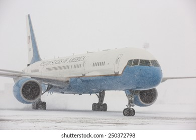 """BORISPOL, UKRAINE - FEBRUARY, 5, 2015:  The aircraft with the words """"United States of America"""" on the board on the landing strip of Borispol Airport during heavy snowfall"""