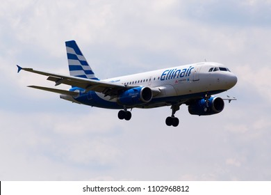 Borispol, Ukraine - May 25, 2018: SX-EMB Ellinair Airbus A319-100 aircraft on the cloudy sky background. Editorial use only