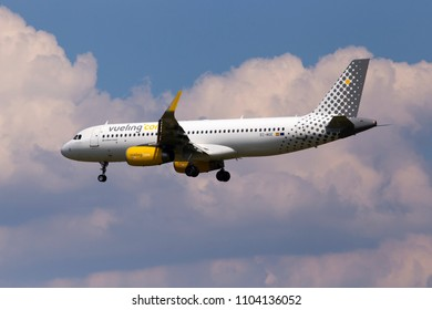 Borispol, Ukraine - May 25, 2018: EC-MGE Vueling Airbus A320-200 aircraft on the cloudy sky background. Editorial use only