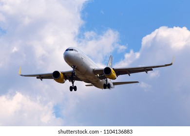 Borispol, Ukraine - May 25, 2018: EC-MJB Vueling Airbus A320-200 aircraft on the cloudy sky background. Editorial use only