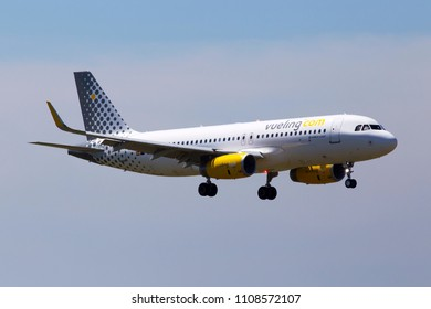 Borispol, Ukraine - May 26, 2018: EC-MXP Vueling Airbus A320-200 aircraft on the cloudy sky background. Editorial use only