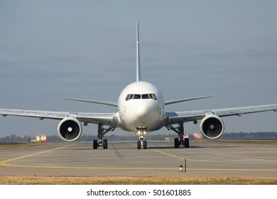 Borispol, Ukraine - October 23, 2011: Boeing 767 is taxiing along the runway in the airport lit with the sun - front view