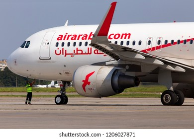 Borispol, Ukraine - September 03, 2018: A ground control manager prepares for departing of A6-AOH Air Arabia Airbus A320-200 from Borispol International Airport