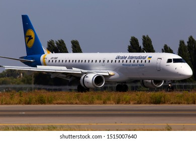 Borispol, Ukraine - September 10, 2019: UR-EMF Ukraine International Airlines Embraer ERJ-195 aircraft landing on the runway of Borispol International Airport