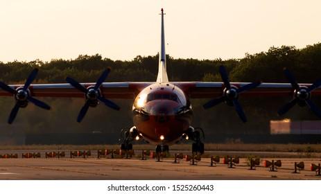 Borispol, Ukraine - September 10, 2019: UR-CSI Cavok Airlines Antonov An-12A four-engined turboprop aircraft in the sunset rays running on the runway of Borispol International Airport