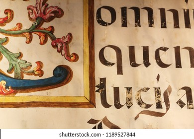Borja, Spain - September 09, 2017: A close up view of an old book sheet made of parchment with some blackletter Latin writings and a colored miniature