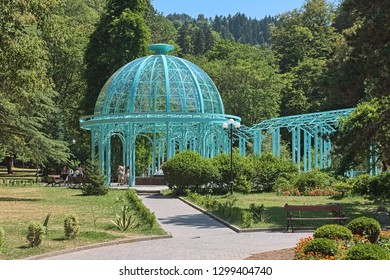 BORJOMI, GEORGIA - AUGUST 14, 2014: Pavilion above the Yekaterininskiy Spring of mineral water in Central Park. The spring was named in 1841 by Yevgeni Golovin, viceroy of Russian Tsar in Caucasus.