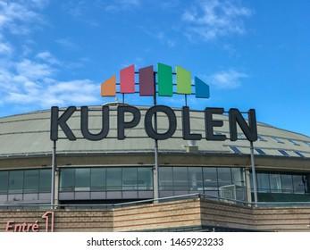 BORLANGE, SWEDEN - JULY 22,  2019:  Kupolen shopping mall in Borlange city, Dalarna Sweden. With a blue sky. Summertime.