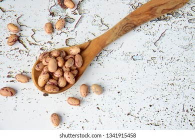 Borlotti beans or Cranberry beans on white background, flat lay