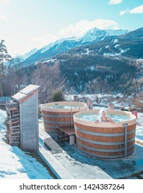 Bormio, Italy - December 21, 2017: A girl in the luxury spa of QC Terme Bagni Nuovi with snow outdoor