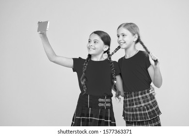 Born to be internet superstar. Girls take selfie smartphone. Take perfect photo. Girls just want to have fun. Schoolgirls use mobile phone smartphone taking photo. Selfie photo for social networks.