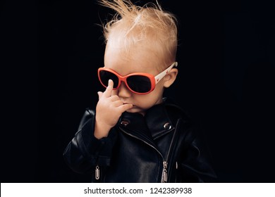 Born to be rock and roll star. Adorable small music fan. Little child boy in rocker jacket and sunglasses. Little rock star. Rock style child. Rock and roll fashion trend. Music for children.