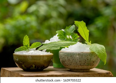 Borneol camphor,Menthol and Camphor in a cup made of green banana leaves on natural background.