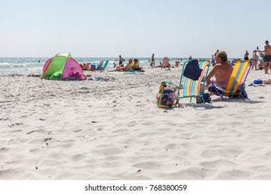 BORNHOLM, DENMARK, JULY 2014, people enjoying a sunny summer day at the beach.
