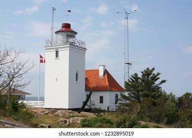 Bornholm. June-09-2012. White lighthouse on the island Bornholm. Denmark