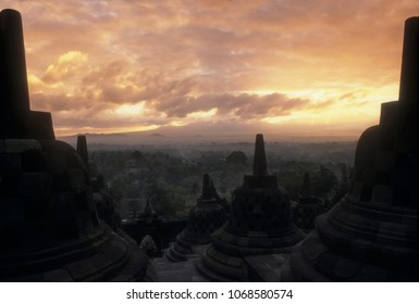 Borobodur at dramatic sunsrise with coudy orange sky