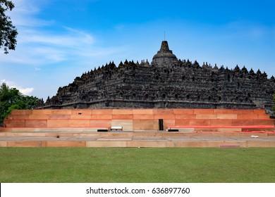Borobodur main stupa and a stage under construction, blue sky in background / preparing for the waisak - vesak - vesakha day