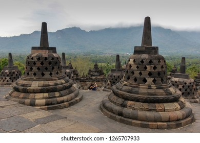 Borobudur Temple, an ancient Buddhist temple under white clouds, Indonesia