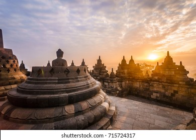 The Borobudur temple with the buddha at morning during sunrise.