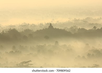 Borobudur Temple, as can be seen from Punthuk Setumbu,Magelang, Indonesia - 2014. The silhouette of the temple beautifully fade in from the misty morning of Borobudur Village.