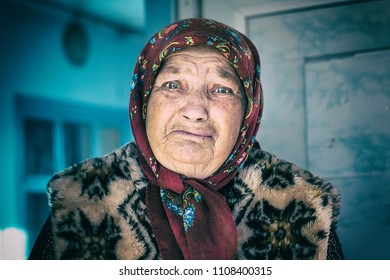 BOROGANI, REPUBLIC OF MOLDOVA - JANUARY 10, 2018 - Portrait of old lonly and sad woman in headscarf. Concept of people traditions