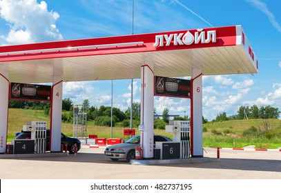 BOROVICHI, RUSSIA - JUNE 26, 2016: Lukoil gas station with fueling cars. Lukoil is the largest privately owned oil and gas company in the world by proved oil reserves