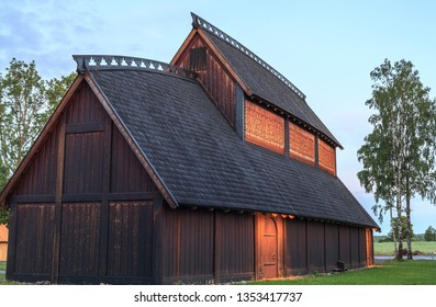 Borre, Vestfold, Norway - June 21, 2018: A replica of a Viking age Gildesal, or Longhouse/Banquet Hall, in Borreparken - an area with burial mounds from 600 CE to 900 CE.