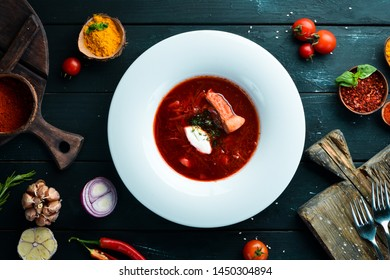 Borsch. Beet soup. Ukrainian cuisine. On a wooden background. Top view. Free space for your text.