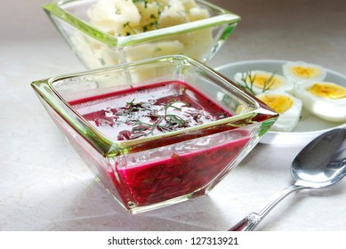 Borscht with beet and eggs, served with hot potatoes
