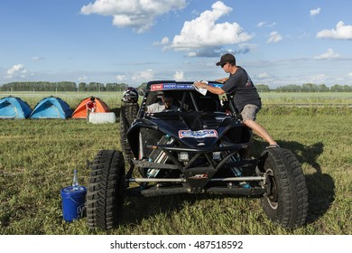 BORTALA, CHINA-JULY 16, 2016: Mechanics cater to sports cars and trucks day and night during the Silk Way rally Moscow-Beijing Dakar series