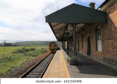 Borth, Ceridigion, Wales, UK. May 28, 2019.  A train departing the station for Aberystwyth.