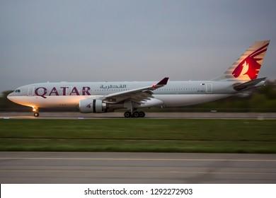 BORYSPIL, UKRAINE - APRIL 26, 2018: Qatar Airways aircraft landing at the airport. Airport runway. Airplane landing. Qatar travel.