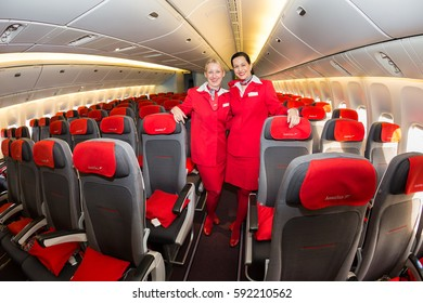 Boryspil, Ukraine - DECEMBER 07, 2016: Stewardesses, cabin crew members. Austrian Airlines Boeing 777. Economy class seats.
