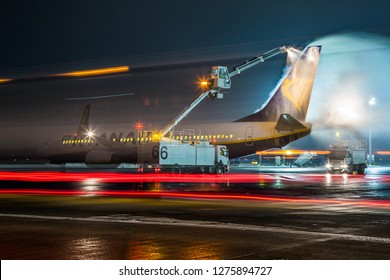 BORYSPIL, UKRAINE - DECEMBER 19, 2018: Winter at the airport. Deicing of the airplane before flight.