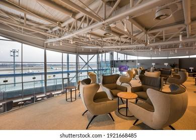 Boryspil, Ukraine - FEBRUARY 15, 2021: Airport business class lounge. International airport interior. Airport VIP lounge. Modern airport