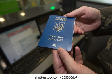 """BORYSPIL, UKRAINE - FEBRUARY, 18, 2015: Specialists of the State Border Guard Service of Ukraine show the system biometric passports control at the airport """"Boryspil"""""""