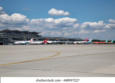 Boryspil, Ukraine - JULY 05, 2014: Airport panoramic view. Airport apron overview. Aircrafts at the gates. Kiev Boryspil International airport. Boryspil airport terminal D.