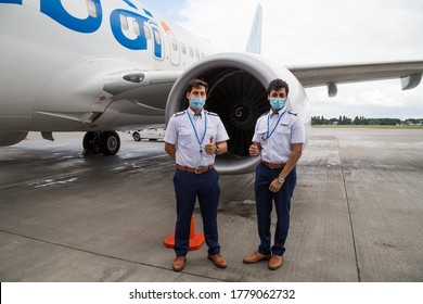 Boryspil, Ukraine - JULY 08, 2020: FlyDubai pilots wearing masks due to COVID-19 safety rules. Airline resuming flights after coronavirus lockdown. Airport safety rules. Dubai travel.