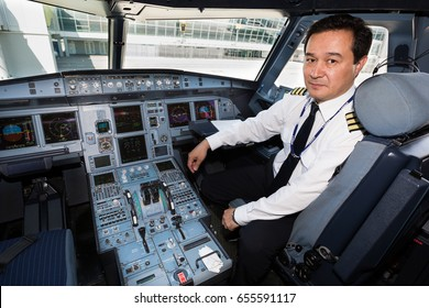 Boryspil, Ukraine - JUNE 01, 2017: Airline pilot at work in the cockpit. Airbus A320 cockpit. Airplane at the airport.