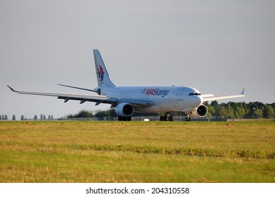 BORYSPIL, UKRAINE - JUNE, 28, 2014: Malaysia Airlines (Maskargo) Airbus A330 - 9M-MUC take off, Boryspil International Airport