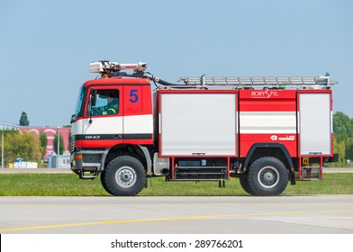 BORYSPIL, UKRAINE - MAY, 20, 2015: Red firetruck Mercedes Benz ride on call fire suppression and mine victim assistance at Boryspil International Airport, Kiev, Ukraine.