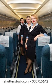 Boryspil, Ukraine - MAY, 2015: Beautiful flight attendants in an airplane. Airbus A320 cabin crew. Aircraft cabin crew. Portrait of stewardesses in an airplane on May 20, 2015 in Boryspil