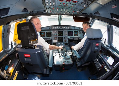 Boryspil, Ukraine - MAY, 2015: Pilots in the cockpit. Airbus A320 cockpit. Airbus A320 airplane at the airport on May 20, 2015 in Boryspil
