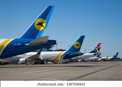 Boryspil, Ukraine - MAY 26, 2018: Airport panoramic view. Airport apron overview. Aircrafts at the airport gates. Kiev Boryspil International airport. Ukraine International airlines. Boeing 777.