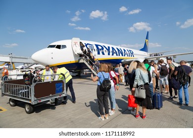 BORYSPIL, UKRAINE - SEPTEMBER 03, 2018: Passengers boarding Ryanair plane. Ryanair airplane at the airport. Low fares airline. Low cost airline.