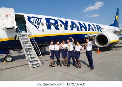 BORYSPIL, UKRAINE - SEPTEMBER 03, 2018: Ryanair flight attendants, cabin crew. Ryanair airline. Low fares airline. Low cost airline. Boeing 737.