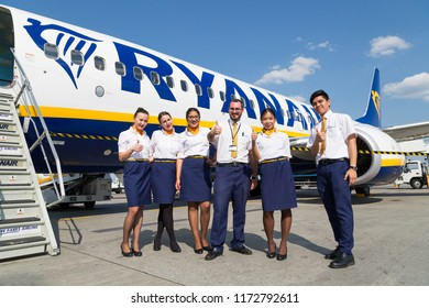 BORYSPIL, UKRAINE - SEPTEMBER 03, 2018: Ryanair flight attendants, cabin crew. Ryanair airline. Low fares airline. Low cost airline. Boeing 737. Thumbs up. Europe travel.
